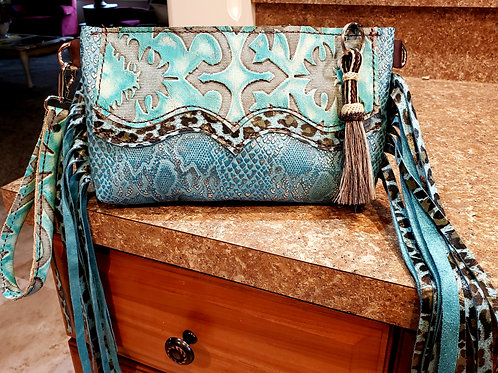 Turquoise Leopard Wristlet Clutch with a Wallet Interior