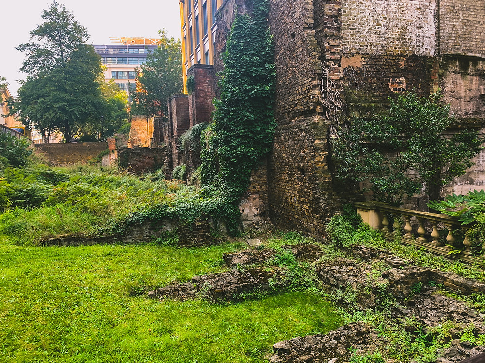 An overgrown piece of land amongst the ruins of the old London wall. A small area of ruggedness in central London.