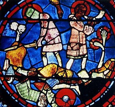 Détail d'un vitrail de la Cathédrale de Chartres (1205-1240) :     Roland sonne l'olifant, après avoir tenté de briser l'épée Durandal.