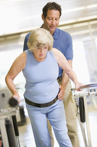 Physiotherapist With Patient In Rehabili