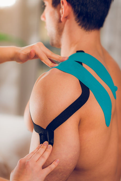 Shoulder treatment with kinesio tape.jpg