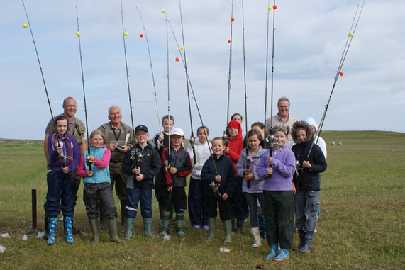 Barra children and Angling Guides headin