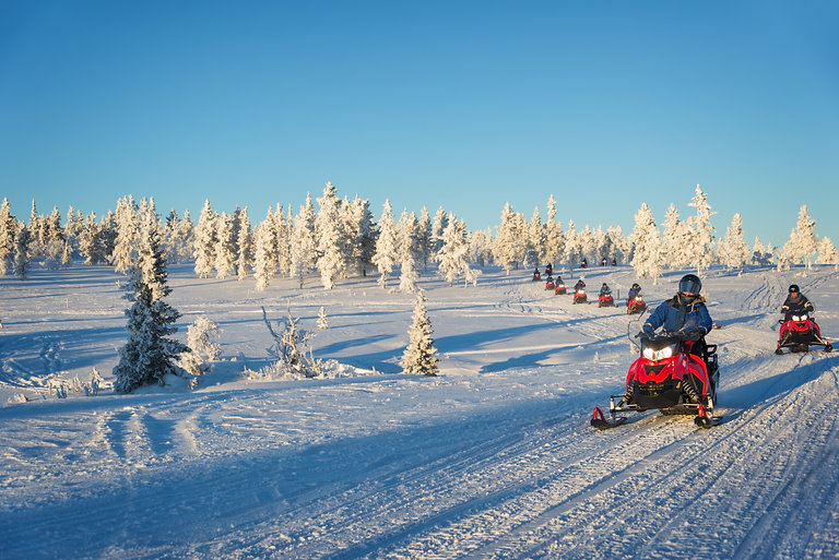 Group of snowmobiles in Lapland, near Sa