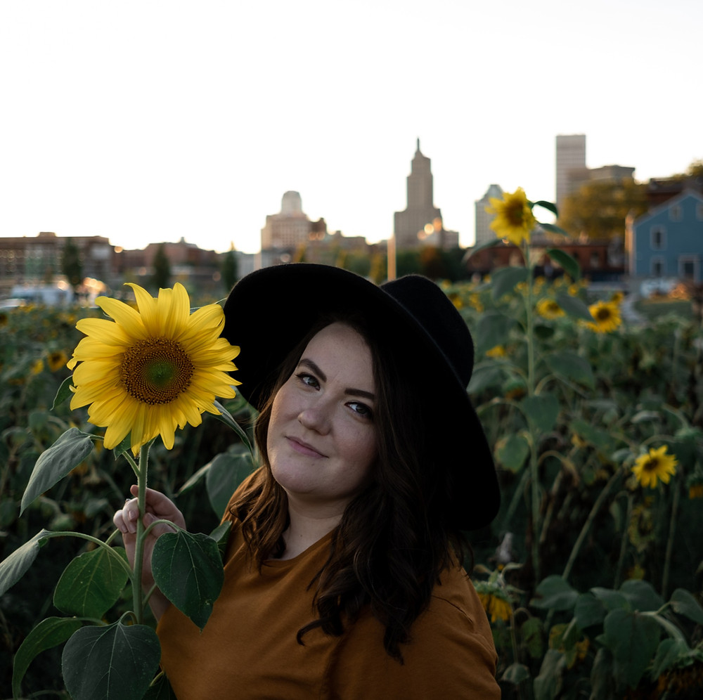 Portrait shoot in the sunflower field of Providence overlooking the city.