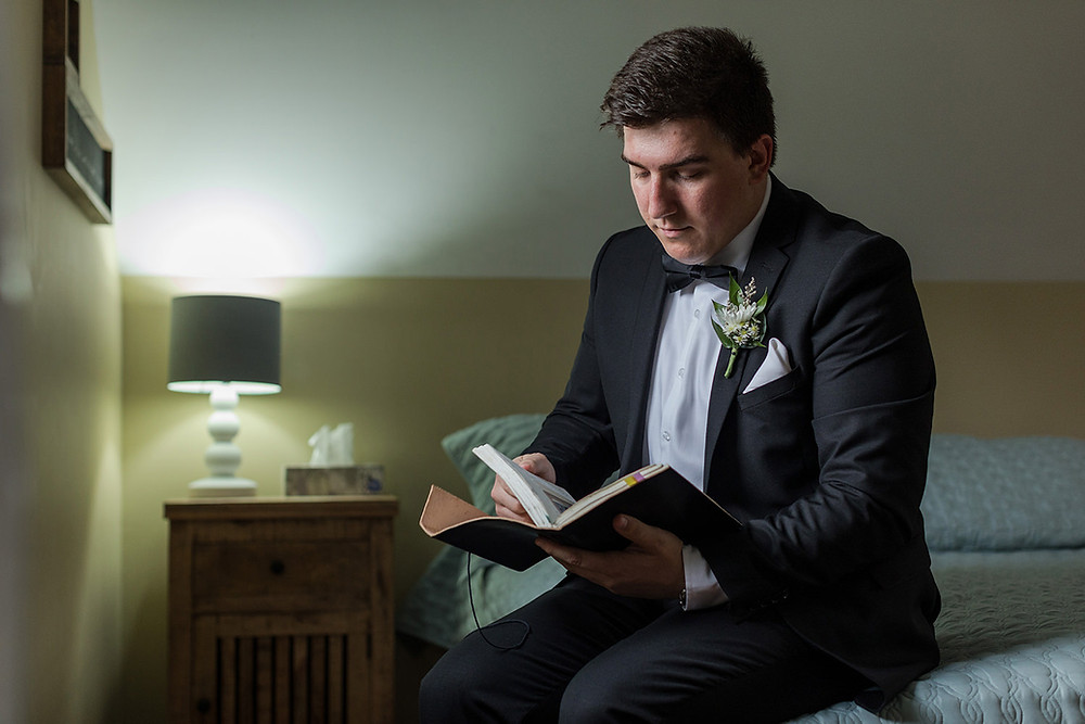 groom reading bride's note - Montreal Intimate wedding - intimate wedding at a 10 acre backyard