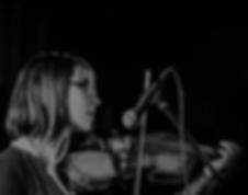 Macail Eve peforming violin