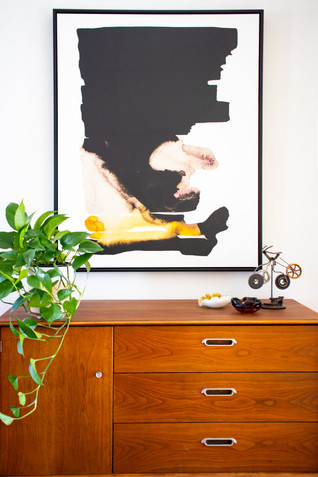 how to hang artwork in your home