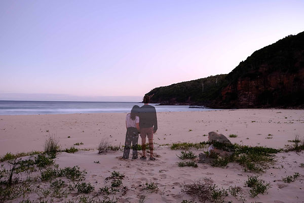 Wandering couple at the beach