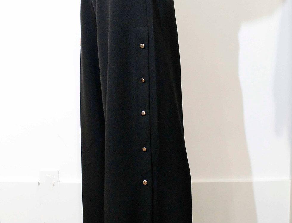 Pantalón tachuelas