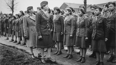 6888 then-Major Charity Adams inspecting