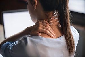 Tired woman massaging rubbing stiff sore