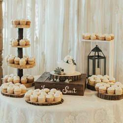 Cutting cake and Cupcakes display