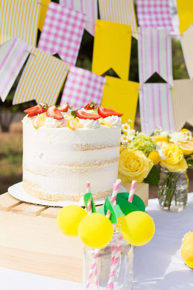 Our naked cake topped with fresh lemons and strawberries