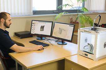 IMG_3d printer + carl at desk 2.jpg