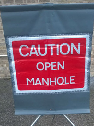 Caution open manhole cover roll-up sign