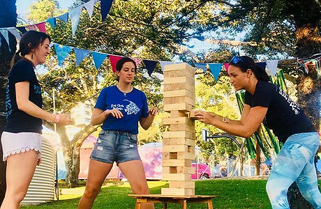 girls playing giant jenga at a party