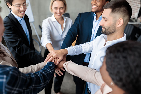 coworkers-holding-hands-during-corporate