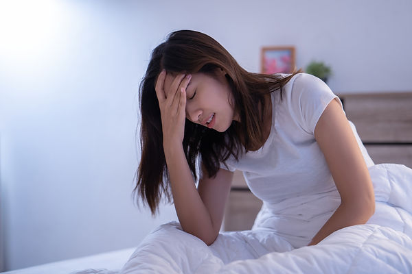 Asian woman have a headaches may be migr