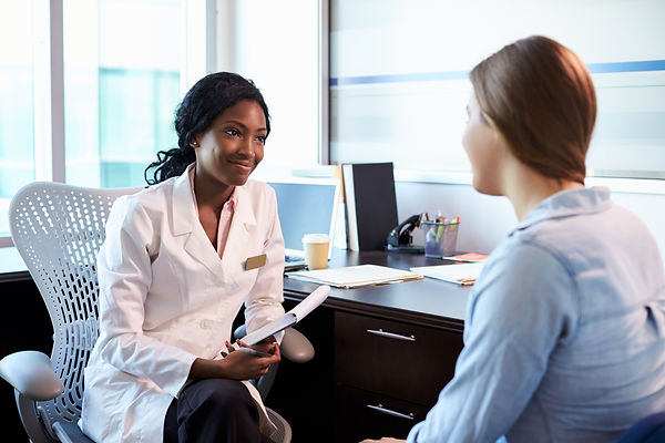 Doctor In Consultation With Female Patie