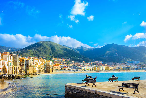 view of beach town of Cefalu in Sicily,