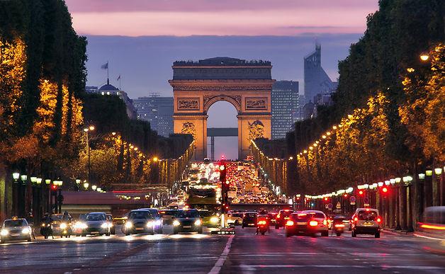 Paris, Champs-Elysees at night. Car traf