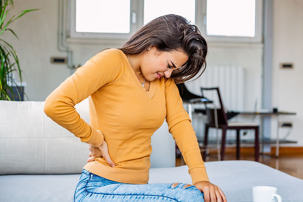Back Pain. Closeup Of young woman Having
