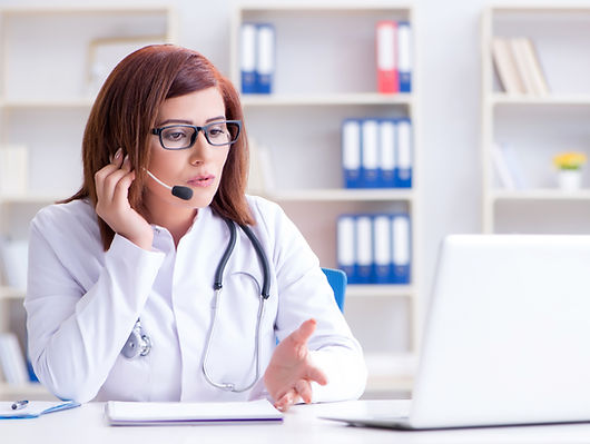 Woman doctor in telemedicine concept.jpg