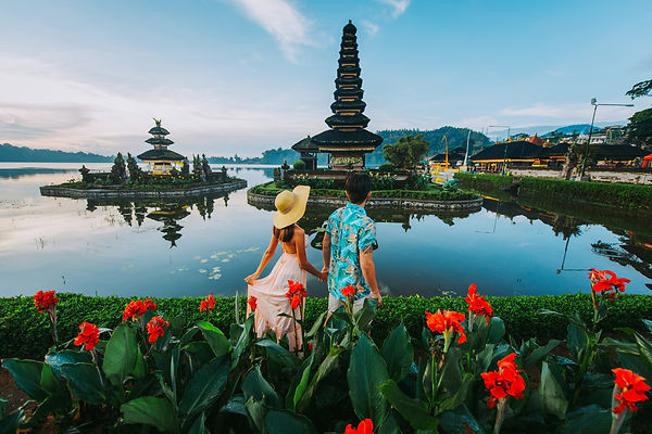 Couple spending time at the ulun datu bratan temple in Bali. Concept about exotic lifestyl
