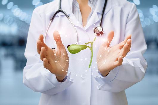Doctor shows gallbladder on blurred back