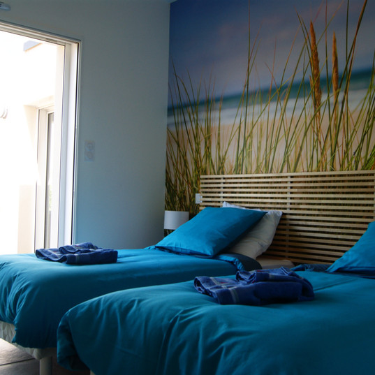 chambre lits simples villa baie
