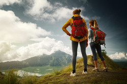 bigstock-Two-hikers-standing-on-top-of--66545632.jpg