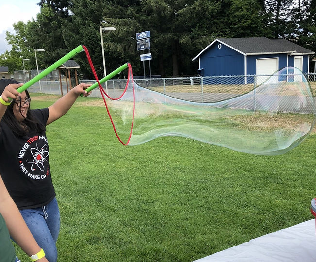 This is a picture of a disabled, teenage, asian american female. She is on the left side of the picture and the rest of the photo is a human-sized bubble.