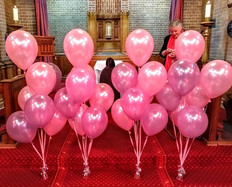 Beautiful pastel pink and lilac funeral balloons.