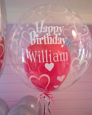 Personalised double bubble balloon arrangement.