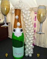 Giant Champagne Bottle Arrangement.