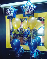 Fab at 30! Gold and navy blue floor standing arrangements.