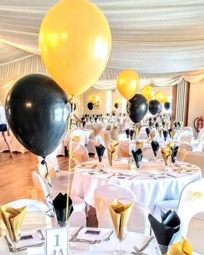 Black and gold balloon arrangements.