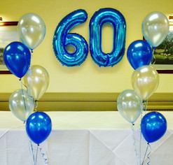 Beautiful blue 60th foil balloons.