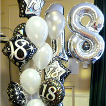 Fab 18th birthday cluster of 18 balloons.