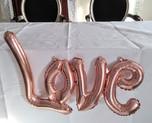 Rose gold LOVE script balloon._edited.jp