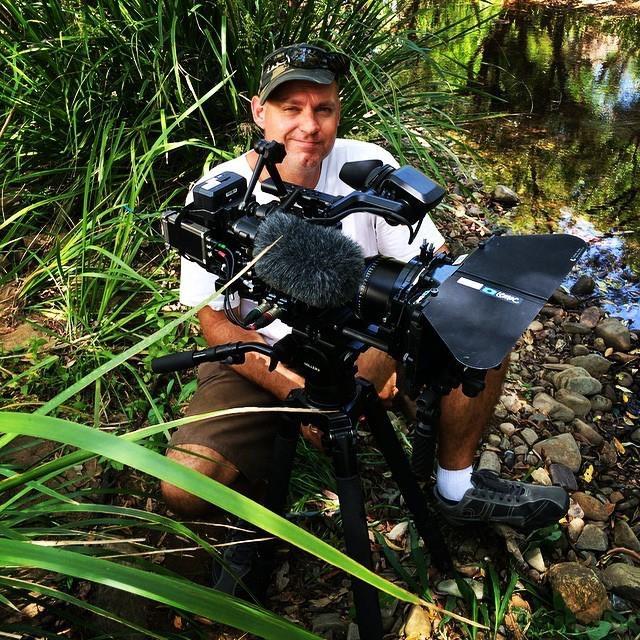 Freelance cameraman on location Brisbane Australia with sound recordist Marty Fa