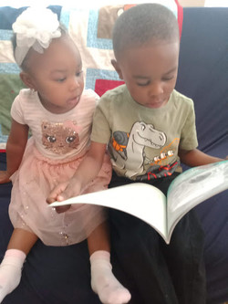 Dillon reading book to Meriah