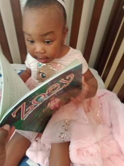 Meriah surprised while looking at book