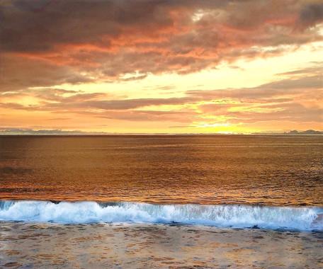 Sunset over ocean HB wave crashing