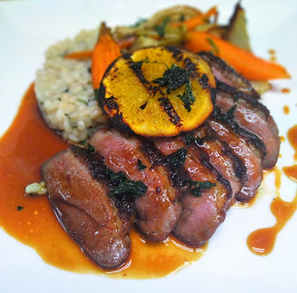 Grilled Orange on sliced duck breast with barley risotto