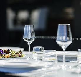Table setting with glasses and plates