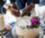 Gay Couple Hands Cutting Wedding Cake