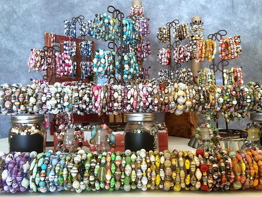 Over 700 artisan paper bead bracelets