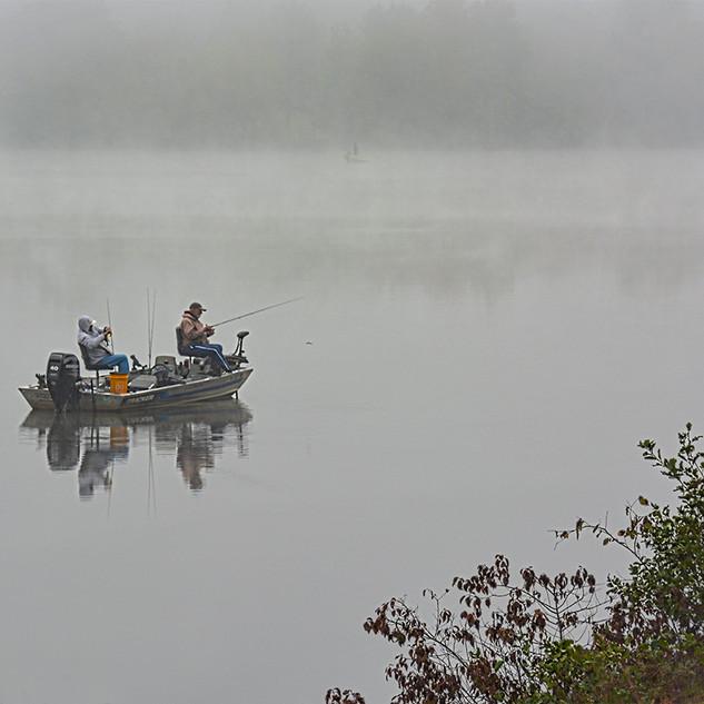 Sitting On Their Bass Fishing