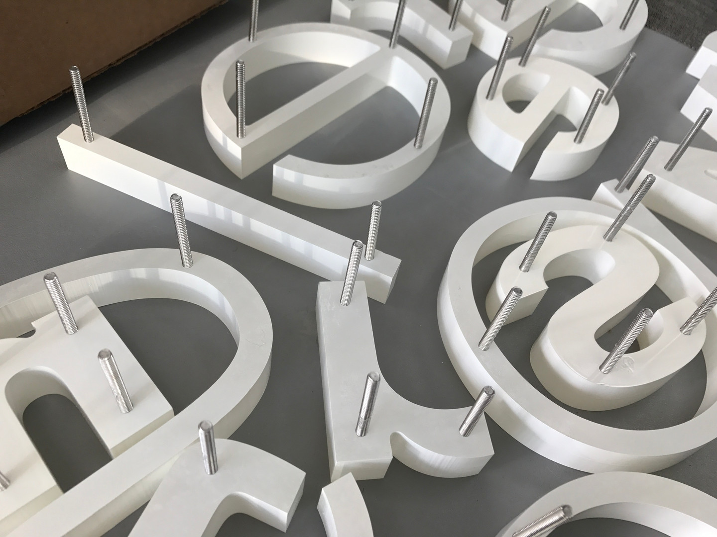 Stud mounted dimensional lettering